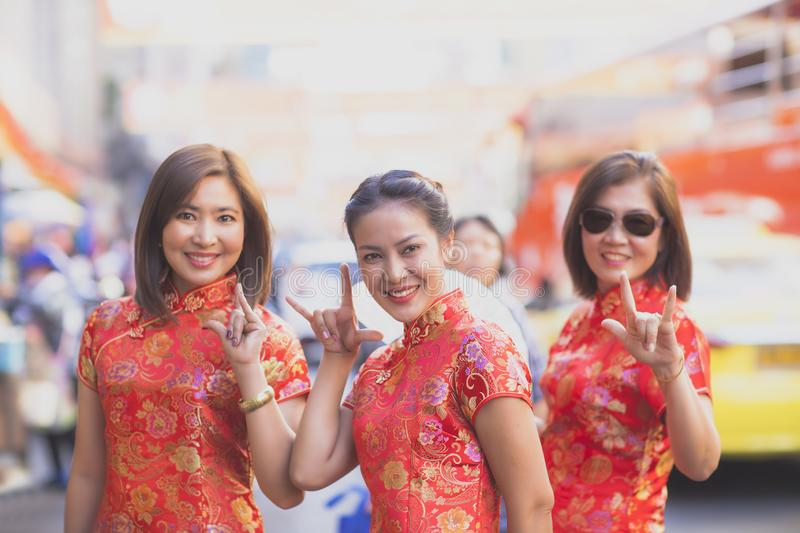 Group of asian woman wearing chinese tradition clothes toothy smiling face happiness emotion and hand sign i love you royalty free stock photos