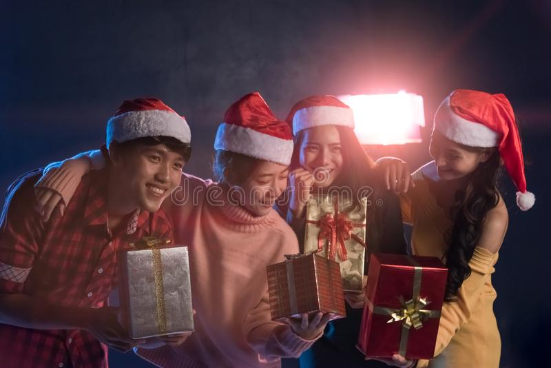 Group Asian young having fun at New Year`s Party, holding Gift B stock photo