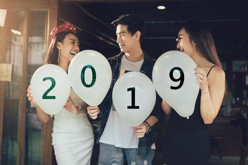 Group of asian young people holding balloon numbers 2019, Celebration New year concept. royalty free stock photos