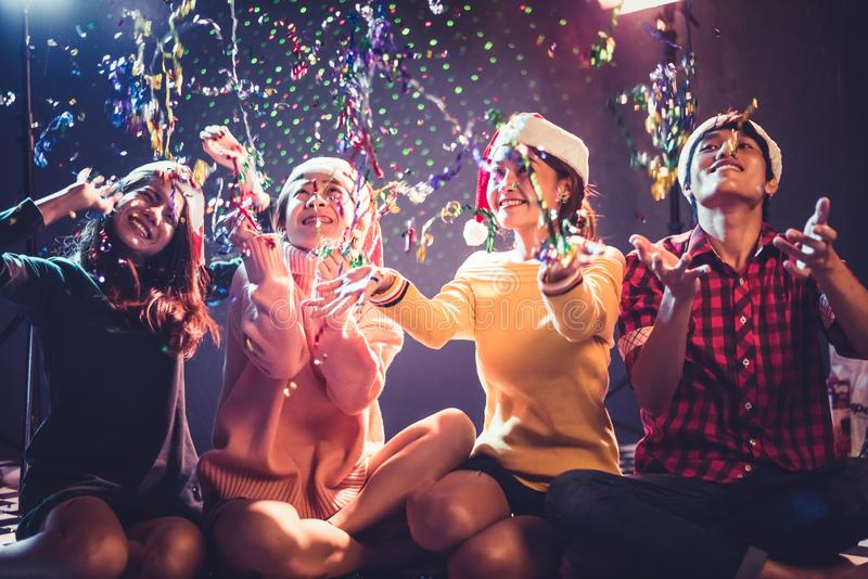 Group of Asian young peoples who celebrating Christmas and New Year. Holiday and Happiness concept. Friendship and Relax theme royalty free stock photography