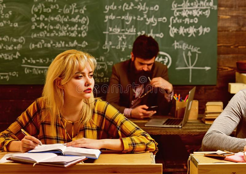 Group of attentive adult students with teacher in classroom at training. Final exam test in university students study royalty free stock photo