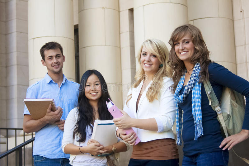Group of Attractive Students. Young, attractive male and female students outside an academic building stock images