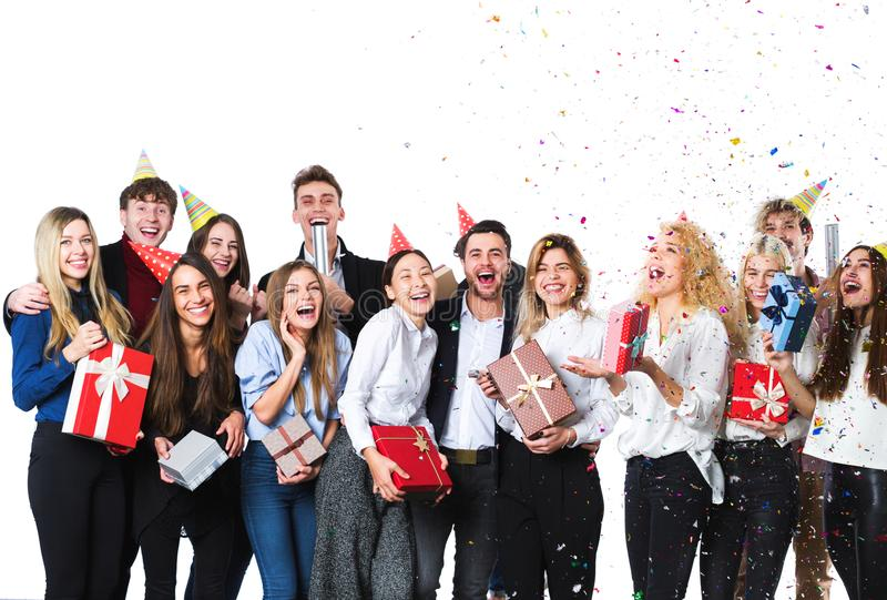 Group of attractive young friends standing over white background. stock images