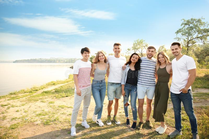 Group of attractive young people outdoors royalty free stock image