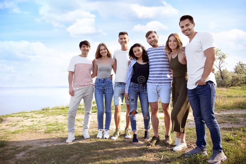 Group of attractive young people outdoors royalty free stock photos