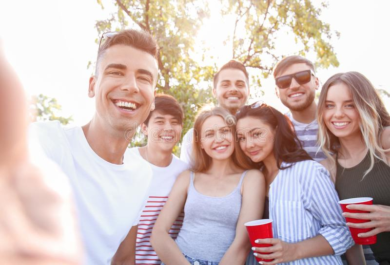 Group of attractive young people taking selfie outdoors royalty free stock image
