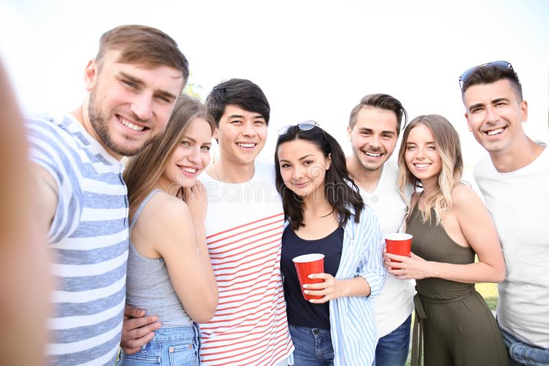 Group of attractive young people taking selfie outdoors stock image