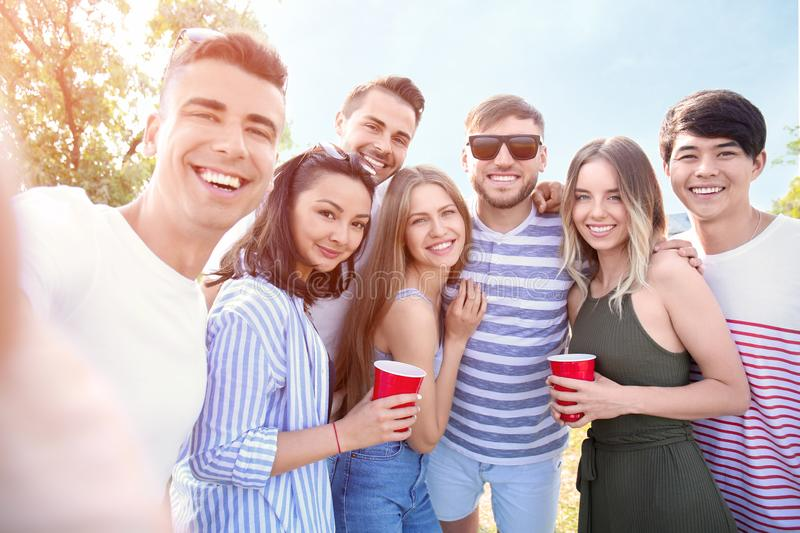 Group of attractive young people taking selfie outdoors royalty free stock photo