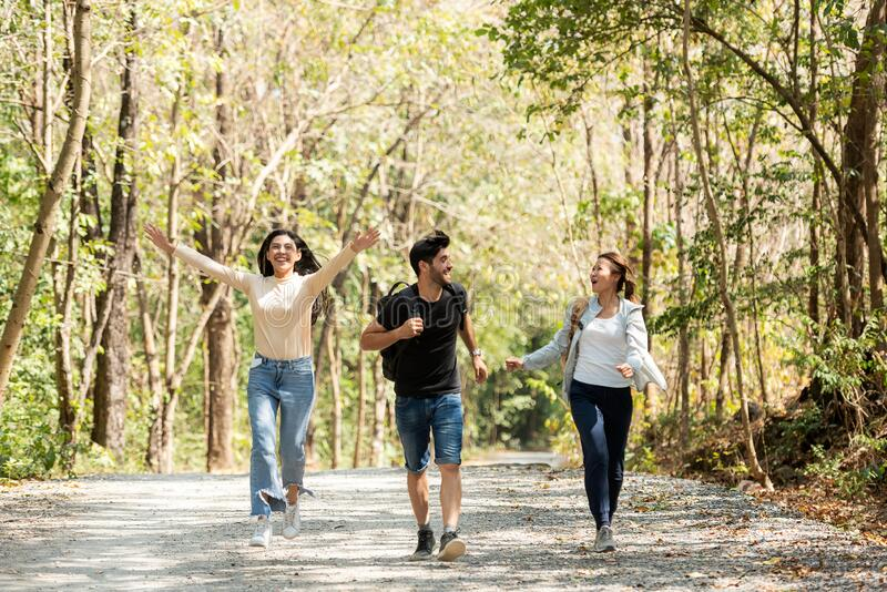 Group backpack people travel and explore adventure in nature. Asian friends and team walking relax stock image