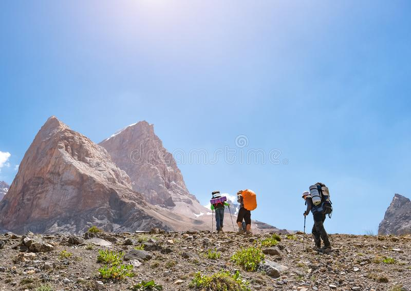 Group of backpackers hiking in Fann mountains. Tajikistan, Central Asia royalty free stock photos