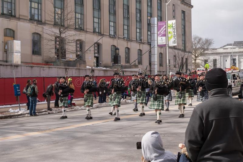 Bagpipers march in St. Patrick`s Day parade stock photography