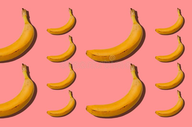 Banana concept. Group of bananas on pink background. Creative s royalty free stock images