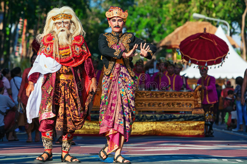 Group of beautiful Balinese men dancers in traditional costumes royalty free stock photo