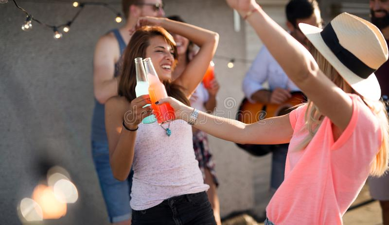 Group of carefree friends dancing have fun in summer royalty free stock photography