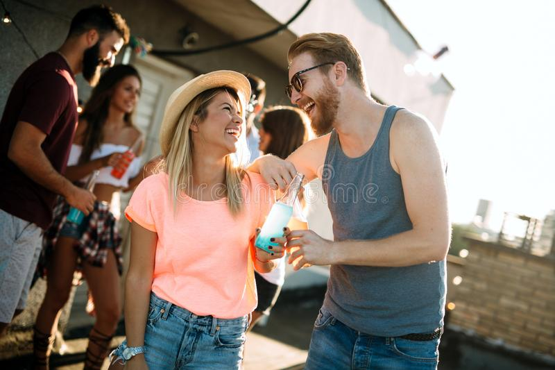 Group of carefree friends dancing have fun in summer stock photo