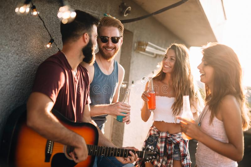Group of carefree friends dancing have fun in summer royalty free stock images