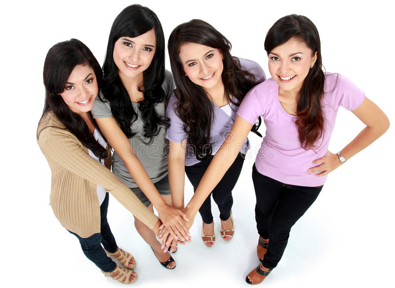 Group of beautiful women with their hands together stock photo