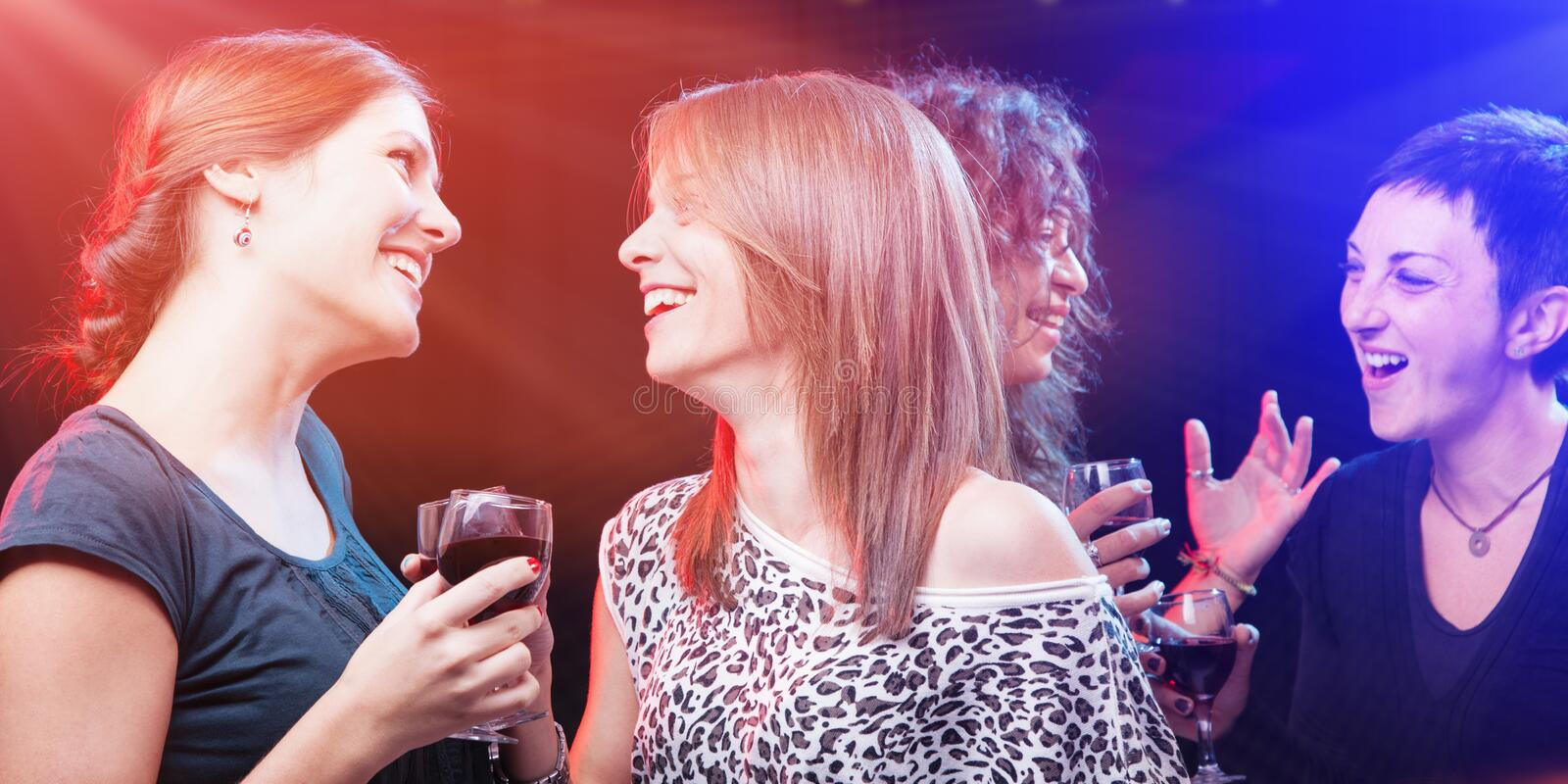 Group of beautiful young friends at the nightclub. royalty free stock photo