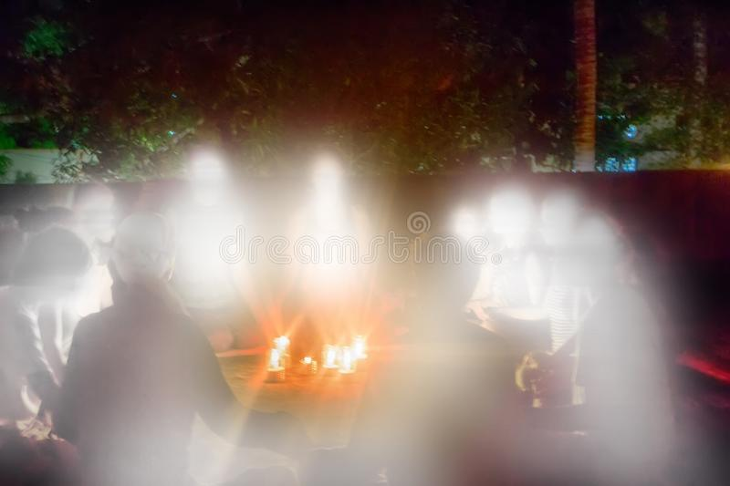 Group of believers gathered nights and formed circle around candles. Eleusinian mysteries, all-night vigils. A group of believers gathered on sundeck and formed royalty free stock images