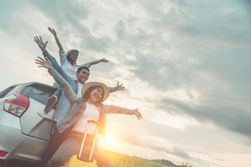 Group of best friends cheering on car road trip at sunset - Happy people outdoor on vacation tour adventure - Friendship concept. At travel together around royalty free stock photo