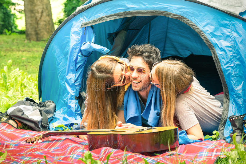 Group of best friends having fun camping together outdoors stock photos