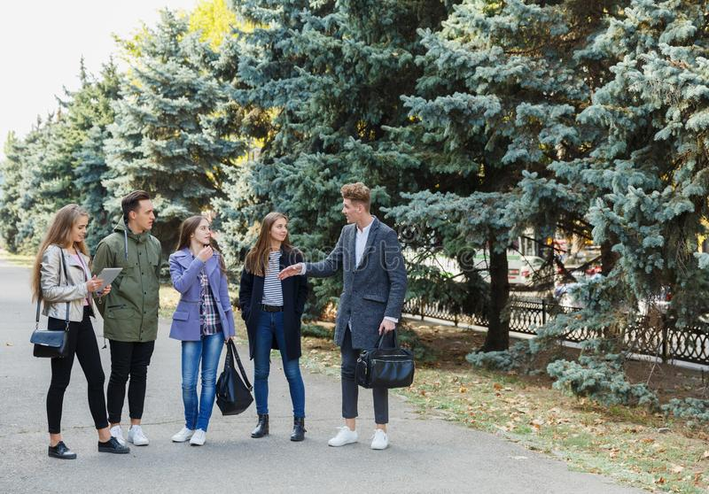 A group of best friends together and walk in the park. royalty free stock photography