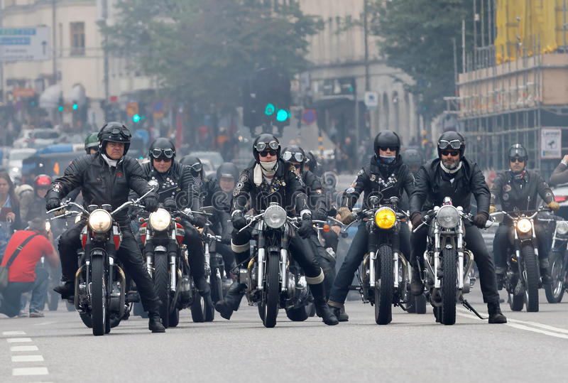 Group of bikers on old fashioned motorcycles stock photos