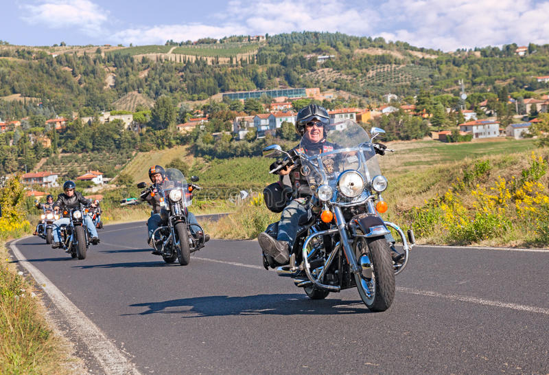 Group of bikers riding Harley Davidson stock images