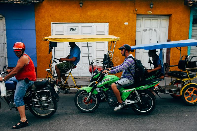 A group of bikes crowed the streets of Trinidad, Cuba. A group of bikes and kabuki`s crowed the streets of Trinidad, Cuba royalty free stock photo