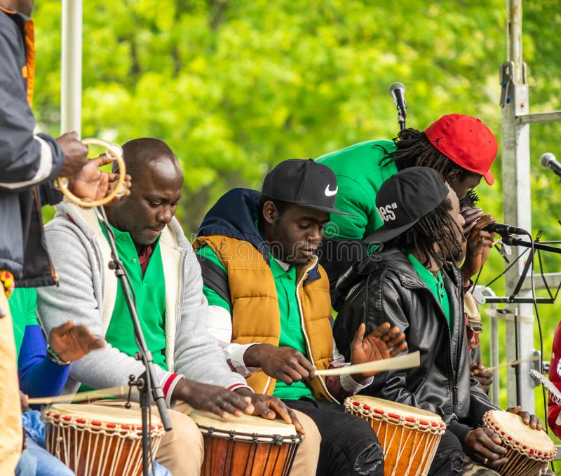 Group of black musicians at a concert with drums at a festival for the first of May, Labour Day stock photos