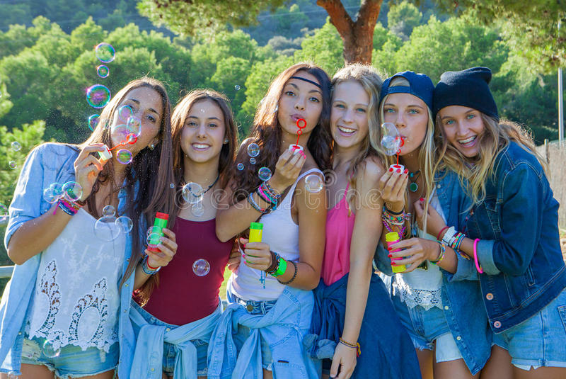 Group blowing bubbles summer kids royalty free stock image