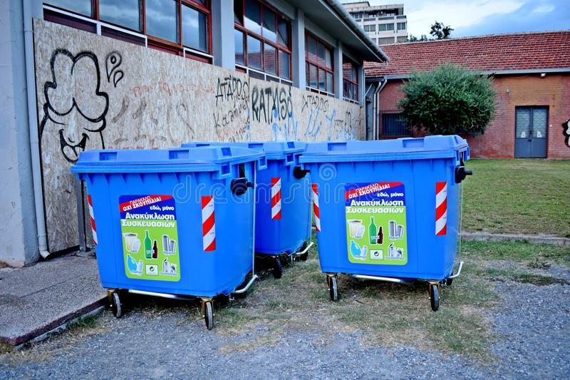 A group of blue recycling bins royalty free stock images