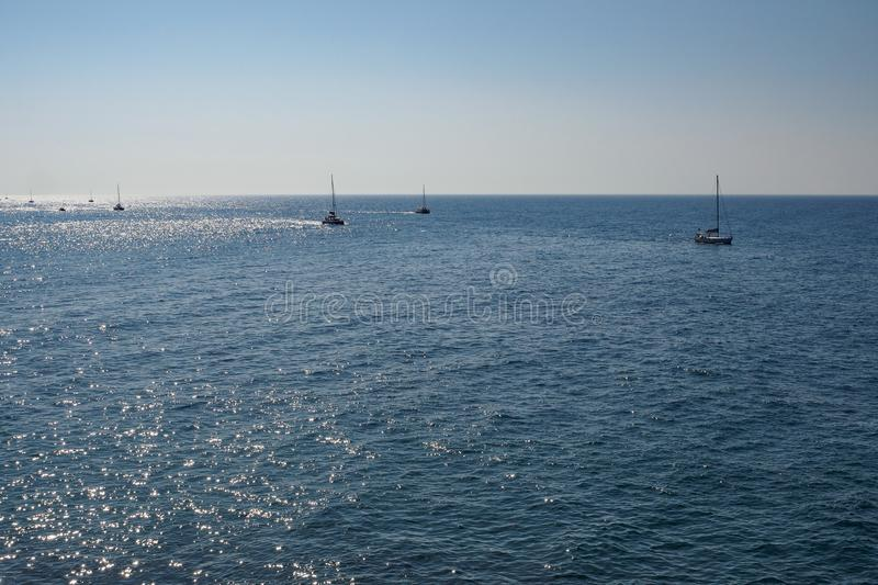 Group of boats sailing on the sea royalty free stock images