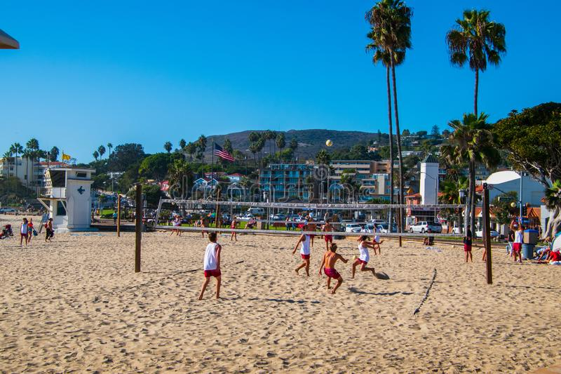 Group of boys playing volley ball on the beach royalty free stock photo