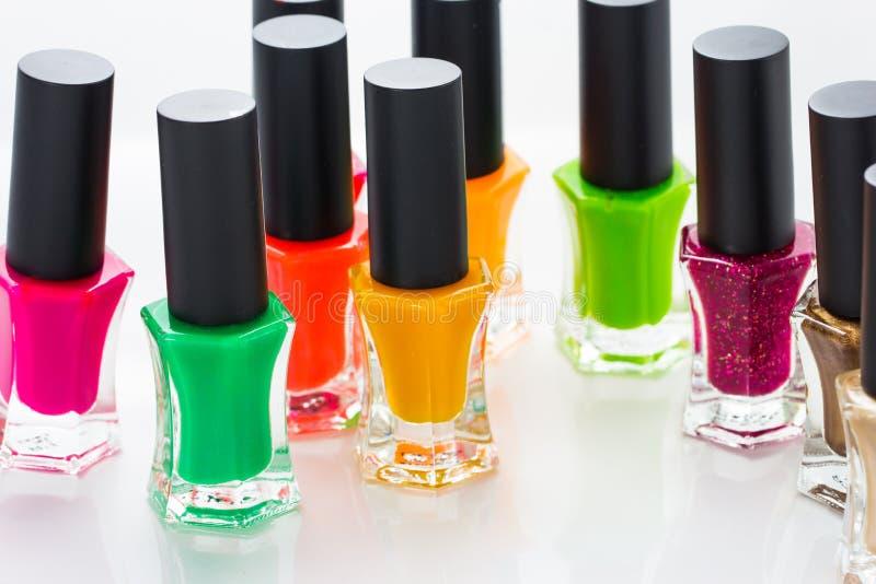 Group of bright nail polishes stock photos