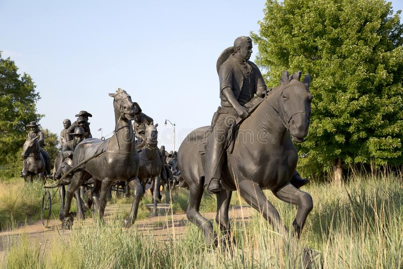 Group bronze sculpture in Centennial Land Run Monument. Sunset, city Oklahoma USA royalty free stock image