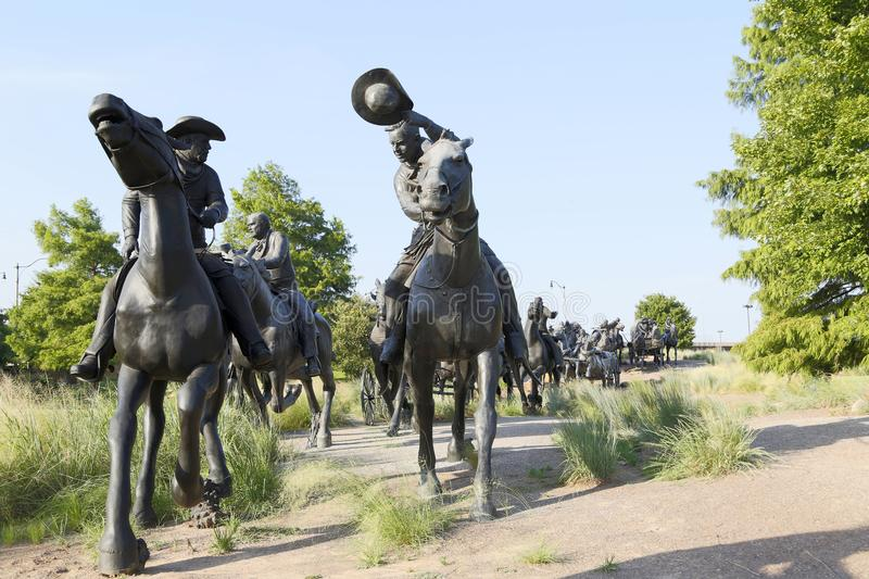 Group bronze sculpture in Centennial Land Run Monument. Sunset, city Oklahoma USA royalty free stock photography