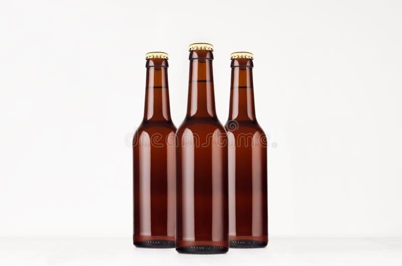 Group brown longneck beer bottle 330ml mock up. stock photography