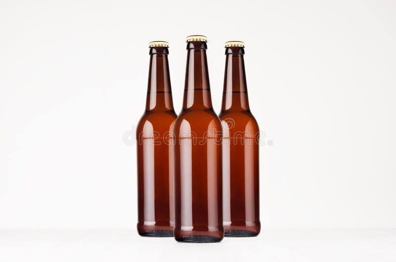 Group brown longneck beer bottles 500ml mock up. stock photography