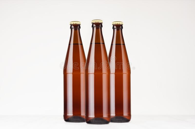 Group brown NRW beer bottles 500ml mock up. stock photos