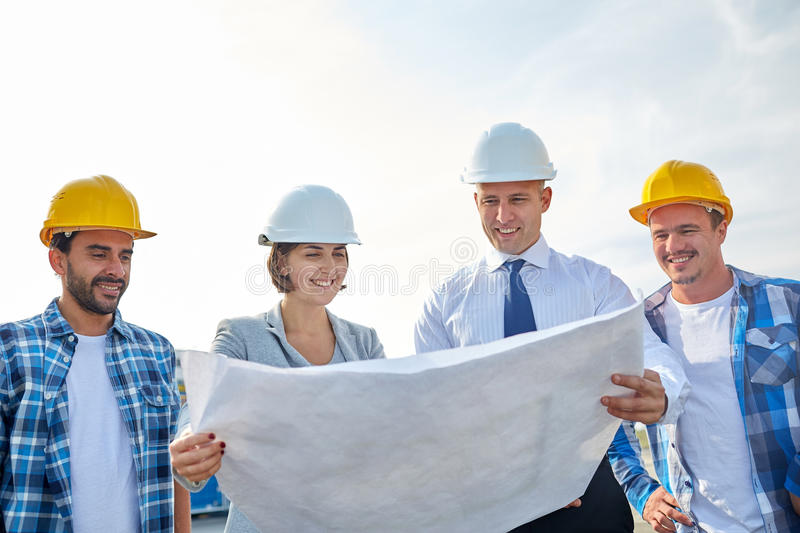 Group of builders and architects with blueprint stock image image download group of builders and architects with blueprint stock image image of construction outdoors malvernweather Images