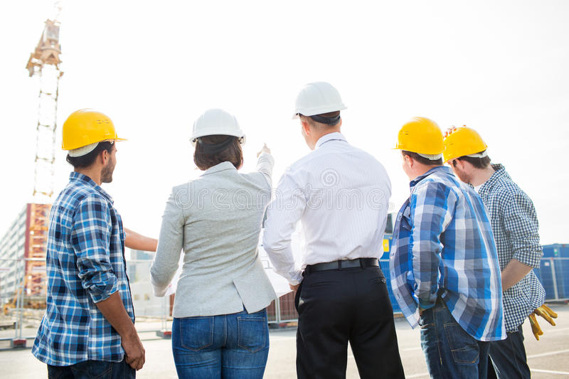 Group of builders and architects at building site stock image download group of builders and architects at building site stock image image of blueprint malvernweather Images