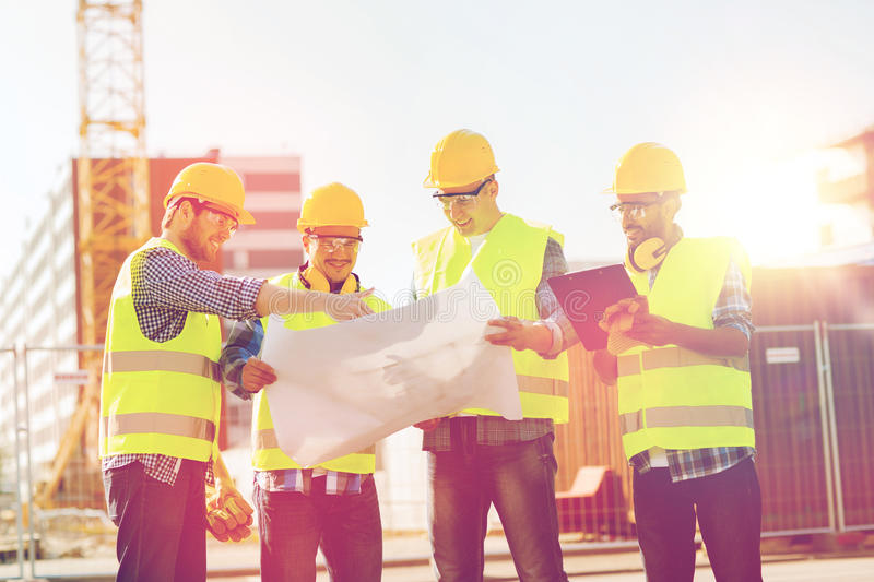 Group of builders with tablet pc and blueprint stock image image download group of builders with tablet pc and blueprint stock image image of development malvernweather Choice Image