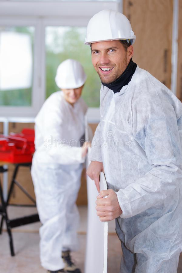 Group builders with wooden boards stock photo