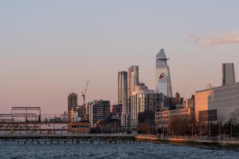 Group of buildings and skyscrapers of Hudson Yards view from pier 26 at sunset in TriBeca District Lower Manhattan New York City royalty free stock photography