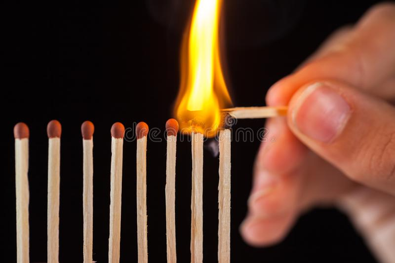 Group of burn and unburned matches, on black background royalty free stock photos