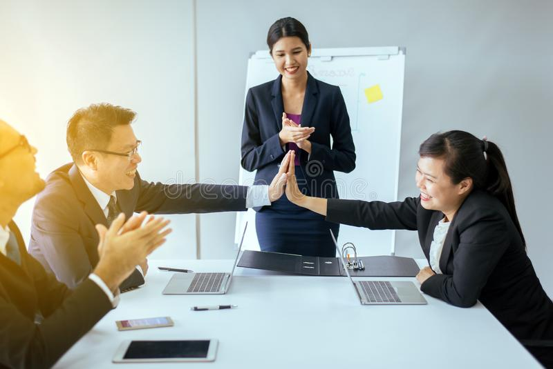 Group of business asian people hands clapping after meeting,Success presentation and coaching seminar at office stock photo