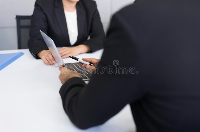 Group of business asian people meeting and working communicating while sitting at room office desk together,Teamwork Concept. Close up royalty free stock photo