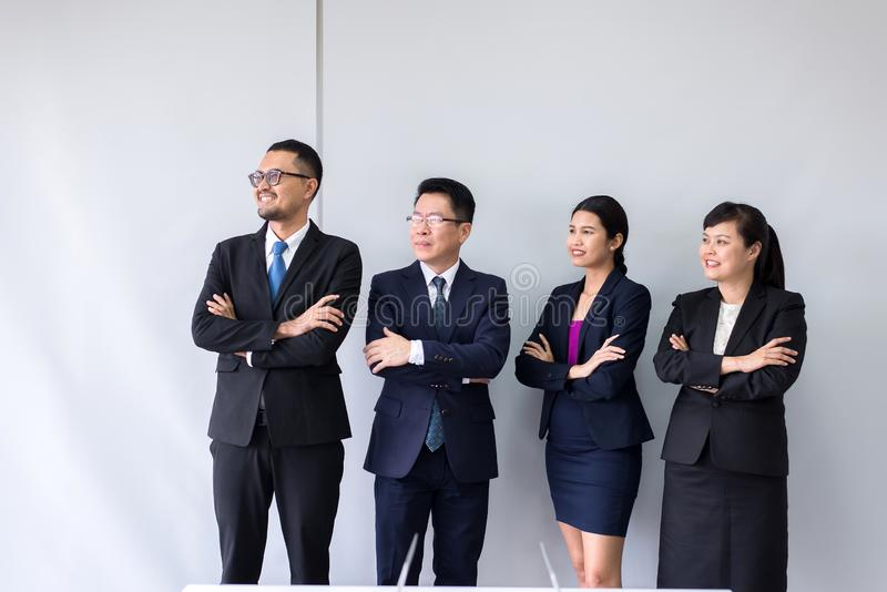 Group of business asian people standing and looking with cross arms after meeting,Success presentation and coaching seminar at off stock photos