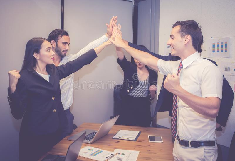 Group business asian people team with success gesture giving hi five in the meeting, agreement royalty free stock photos